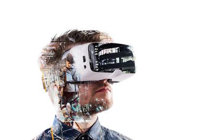 Photo pour Double exposure. Man wearing virtual reality goggles. Night city - image libre de droit