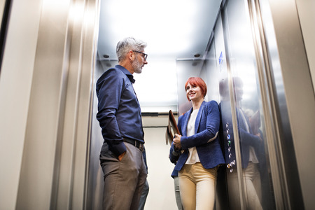 Photo for Business people in the elevator in modern office building. - Royalty Free Image