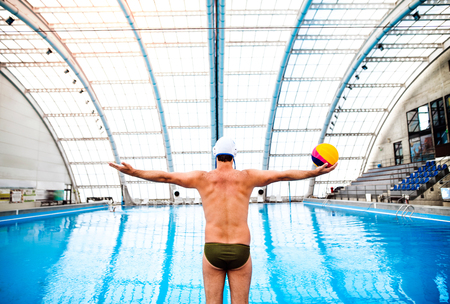 Photo for Water polo player in a swimming pool. - Royalty Free Image