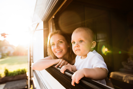Foto de Mother and baby son in a camper van. - Imagen libre de derechos