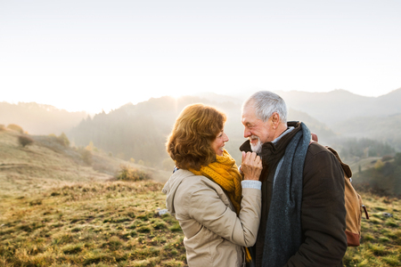 Foto per Senior couple on a walk in an autumn nature. - Immagine Royalty Free