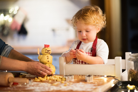 Photo for Toddler boy making gingerbread cookies at home. - Royalty Free Image