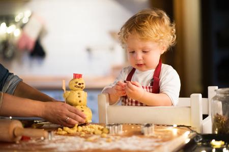 Foto de Toddler boy making gingerbread cookies at home. - Imagen libre de derechos