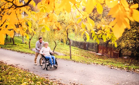 Photo for Senior couple in wheelchair in autumn nature. - Royalty Free Image