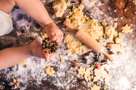 Photo for Young family making gingerbread cookies at home. - Royalty Free Image