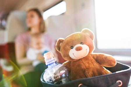 Foto de Young mother travelling with baby by train. - Imagen libre de derechos