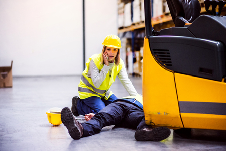 Photo for Warehouse workers after an accident in a warehouse. - Royalty Free Image