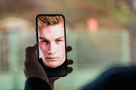 Photo pour A smartphone using face ID recognition system. - image libre de droit
