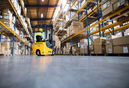 Photo pour Warehouse man worker with forklift. - image libre de droit