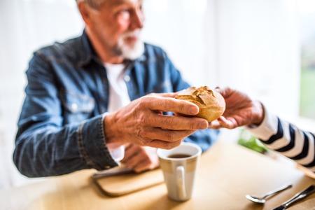 Photo pour Senior couple eating breakfast at home. - image libre de droit