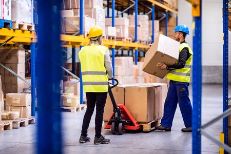 Photo for Young workers in a warehouse. - Royalty Free Image