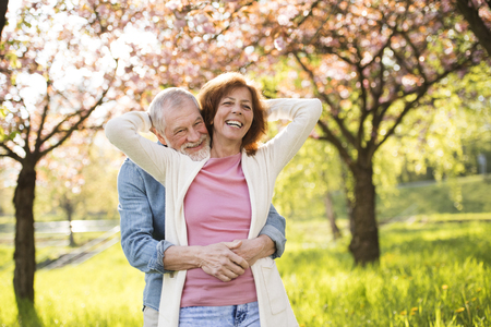 Foto de Beautiful senior couple in love outside in spring nature. - Imagen libre de derechos