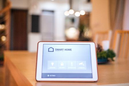 Foto de A tablet with smart home screen. - Imagen libre de derechos