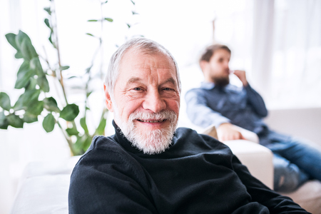 Photo for Hipster son and his senior father at home. - Royalty Free Image