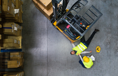 Foto de Warehouse workers after an accident in a warehouse. - Imagen libre de derechos