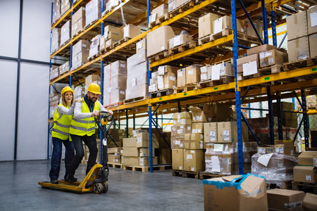 Photo for Two young workers in a warehouse. - Royalty Free Image