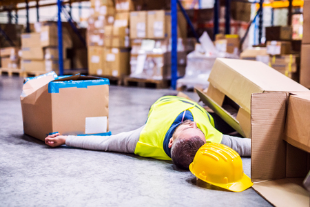 Photo for Warehouse worker after an accident in a warehouse. - Royalty Free Image
