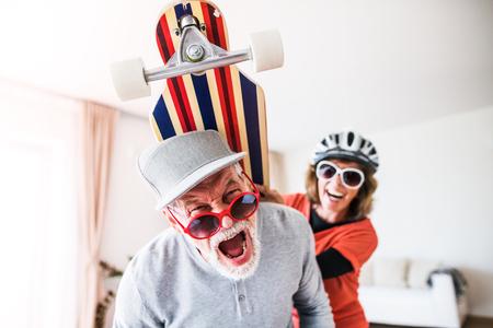 Photo pour Senior couple having fun at home. - image libre de droit