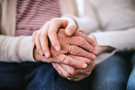 Photo pour Hands of teenage girl and her grandmother at home. - image libre de droit