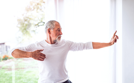 Photo pour Senior man doing exercise at home. - image libre de droit