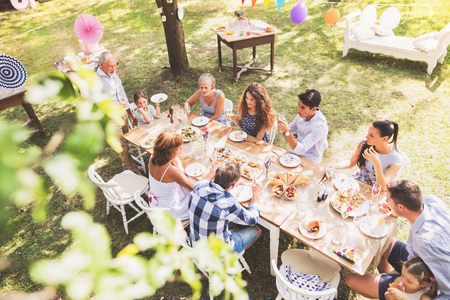 Photo pour Family celebration or a garden party outside in the backyard. - image libre de droit