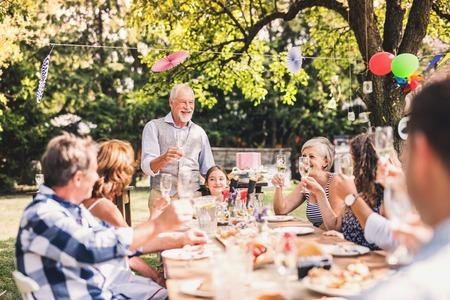 Photo pour Family celebration or a garden party outside in the backyard. - image libre de droit