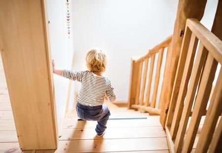 Photo pour Toddler boy in dangerous situation at home. Child safety concept. - image libre de droit