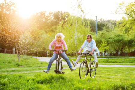 Photo for Beautiful senior couple with bicycles outside in spring nature. - Royalty Free Image