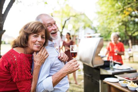 Foto de Family celebration or a barbecue party outside in the backyard. - Imagen libre de derechos