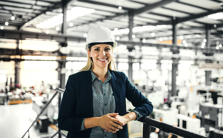 Photo for A portrait of an industrial woman engineer standing in a factory. - Royalty Free Image