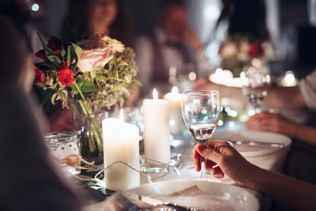 Photo pour A midsection of family sitting at a table on a indoor birthday party, holding glasses. - image libre de droit