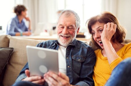 Photo for Senior couple using tablet in community center club. - Royalty Free Image