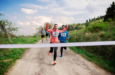 Photo pour Large group of people running a race competition in nature. - image libre de droit