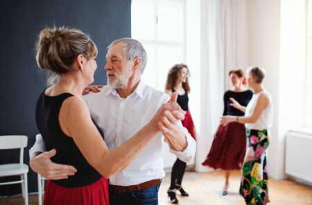 Photo for Group of senior people in dancing class with dance teacher. - Royalty Free Image