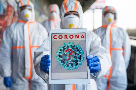 Photo for People with protective suits and respirators outdoors, coronavirus concept. - Royalty Free Image