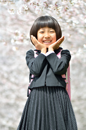 The first grade girl and cherry blossom
