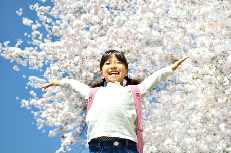 Girl and cherry tree