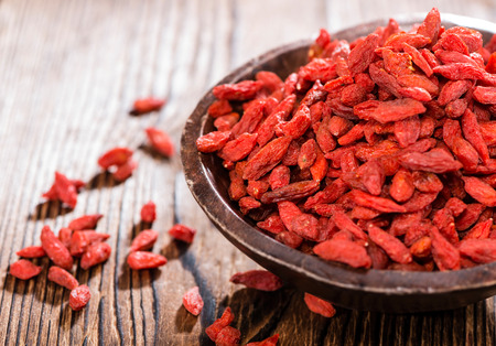 Photo for Portion of ried Goji Berries  in a small bowl - Royalty Free Image