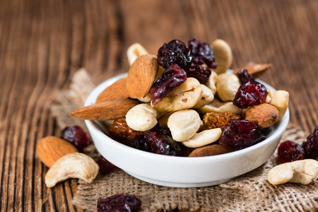 Photo for Wooden table with Trail Mix (selective focus, close-up shot) - Royalty Free Image