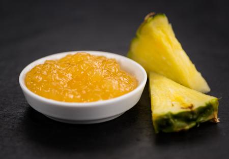 Foto de Portion of Pineapple Jam as detailed close up shot on a slate slab; selective focus - Imagen libre de derechos