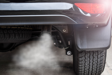 Foto de Exhaust from black car , air pollution concept. - Imagen libre de derechos