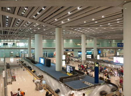 Passengers are taking packages at baggage conveyor area, Beijing international capital airport