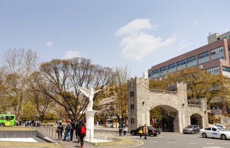 Seoul, Korea - April, 18th 2013. Kyung Hee University is a one of the most famous university in South Korea. It is comprehensive and private. Students are walking along the campus street.