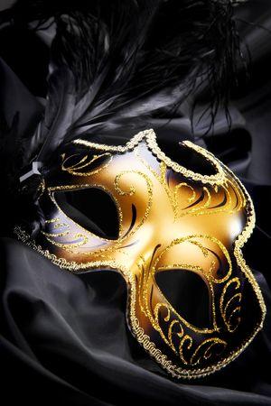 Carnival mask on black silk background