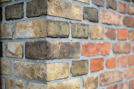 Foto de Corner of a vintage brick wall -  stone brick wall edge - Imagen libre de derechos