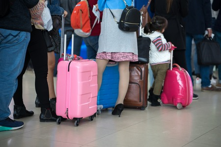 Photo pour Queue of Asian people waiting at boarding gate at airport. Closeup. - image libre de droit