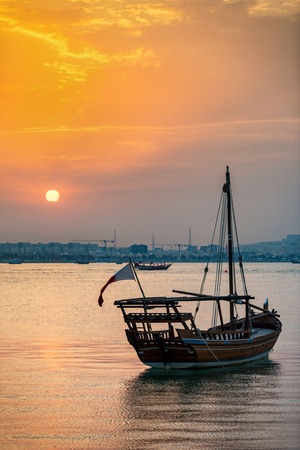 Photo for Traditional Dhow boat at the coast of Doha during sunset, Qatar - Royalty Free Image