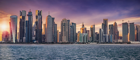 Photo for The skyline of Doha, Qatar, on a cloudy sunset - Royalty Free Image