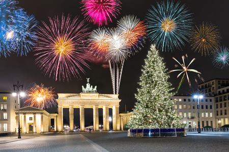 Photo for Brandenburg Gate in Berlin, Germany, with fireworks and Christmas tree - Royalty Free Image