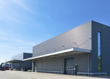 Photo for exterior of a modern warehouse building against a blue sky - Royalty Free Image